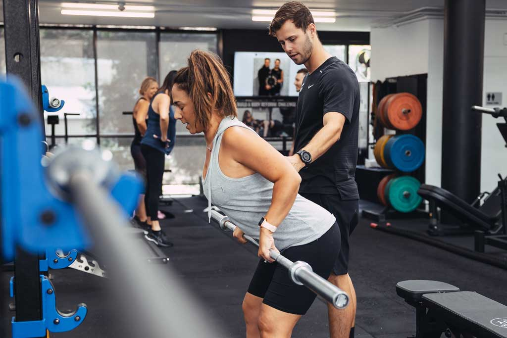 Back strengthening during a personal training session at Build A Body gym in Sydney